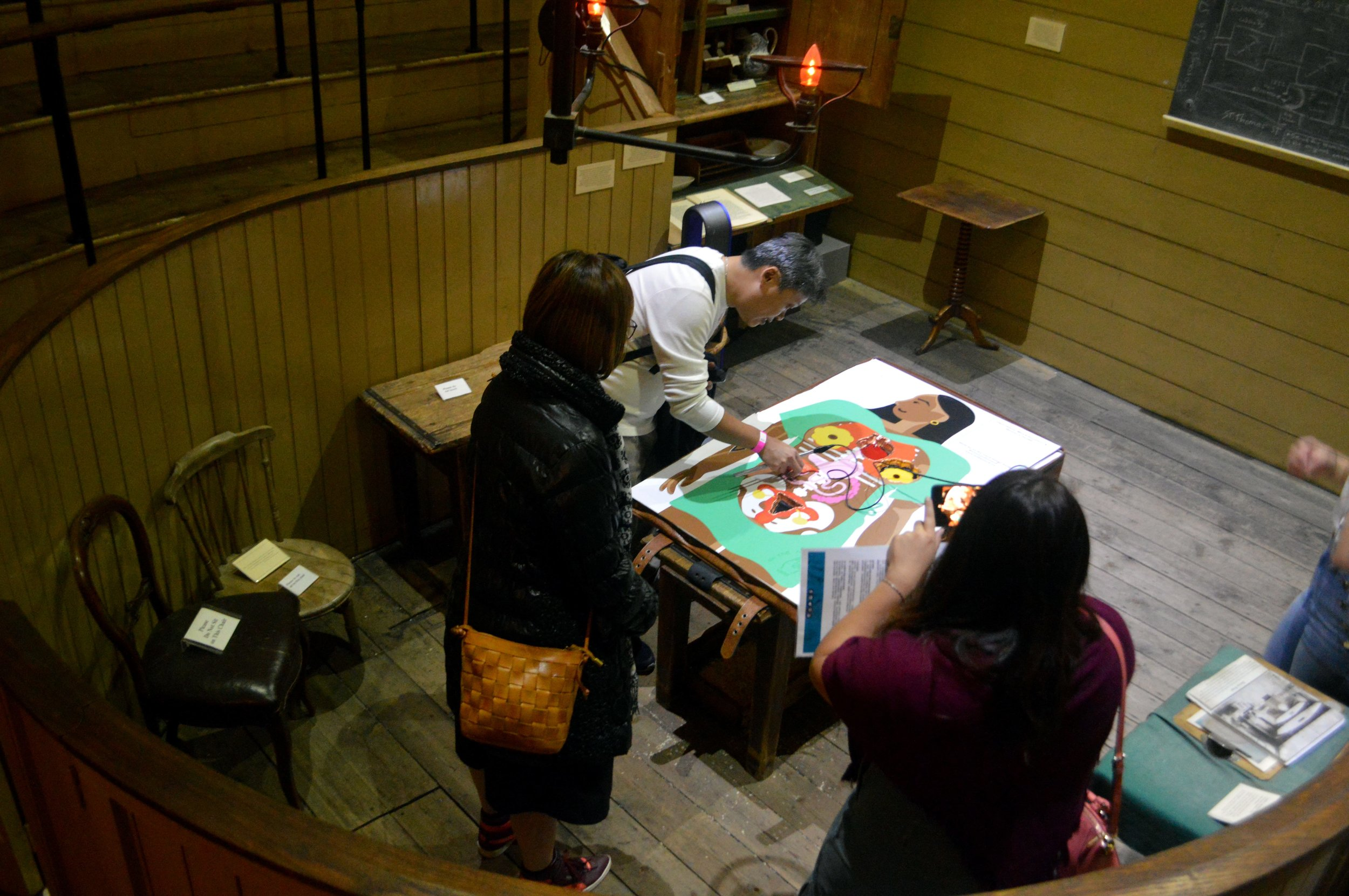 Group of three people playing operation game