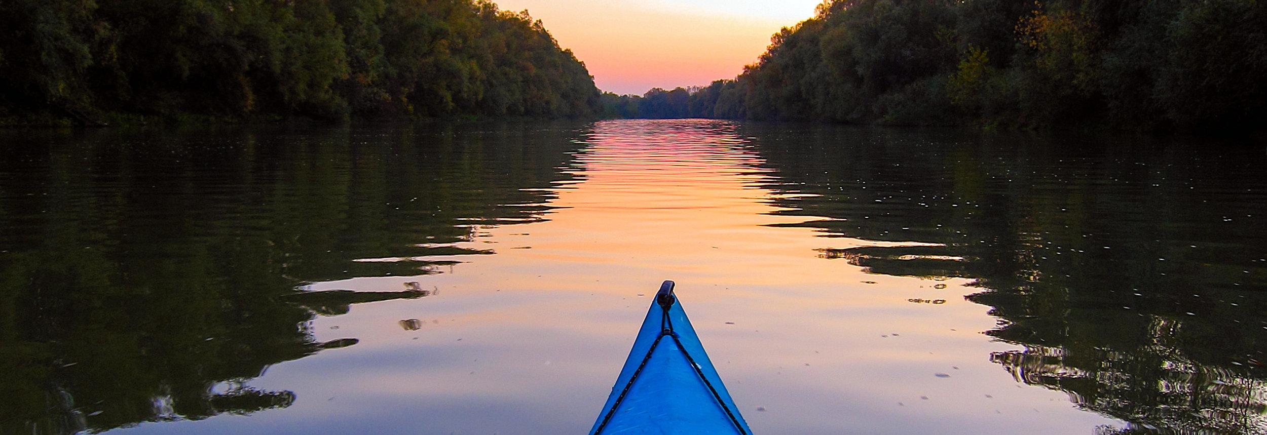 RiverSunsetKayakNose.jpg