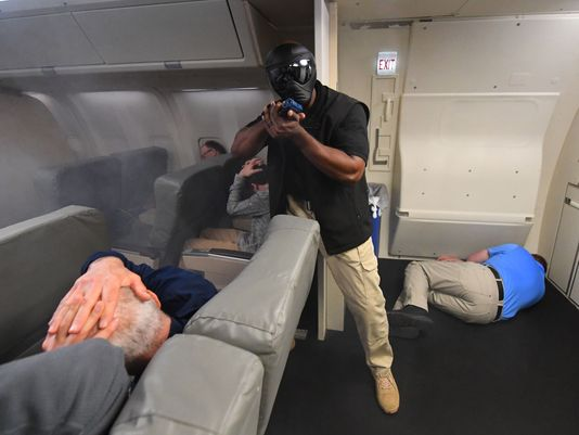 Federal Air Marshals Train Inside A Newton Design Simulator
