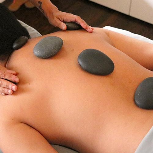 Hot Stone - 60min $95 | 90min $130In this massage, heated stones are placed at specific sites on the body to deepen relaxation and promote circulation in the muscles. Hot stones release tension and stress much more deeply and quickly than a traditional massage.