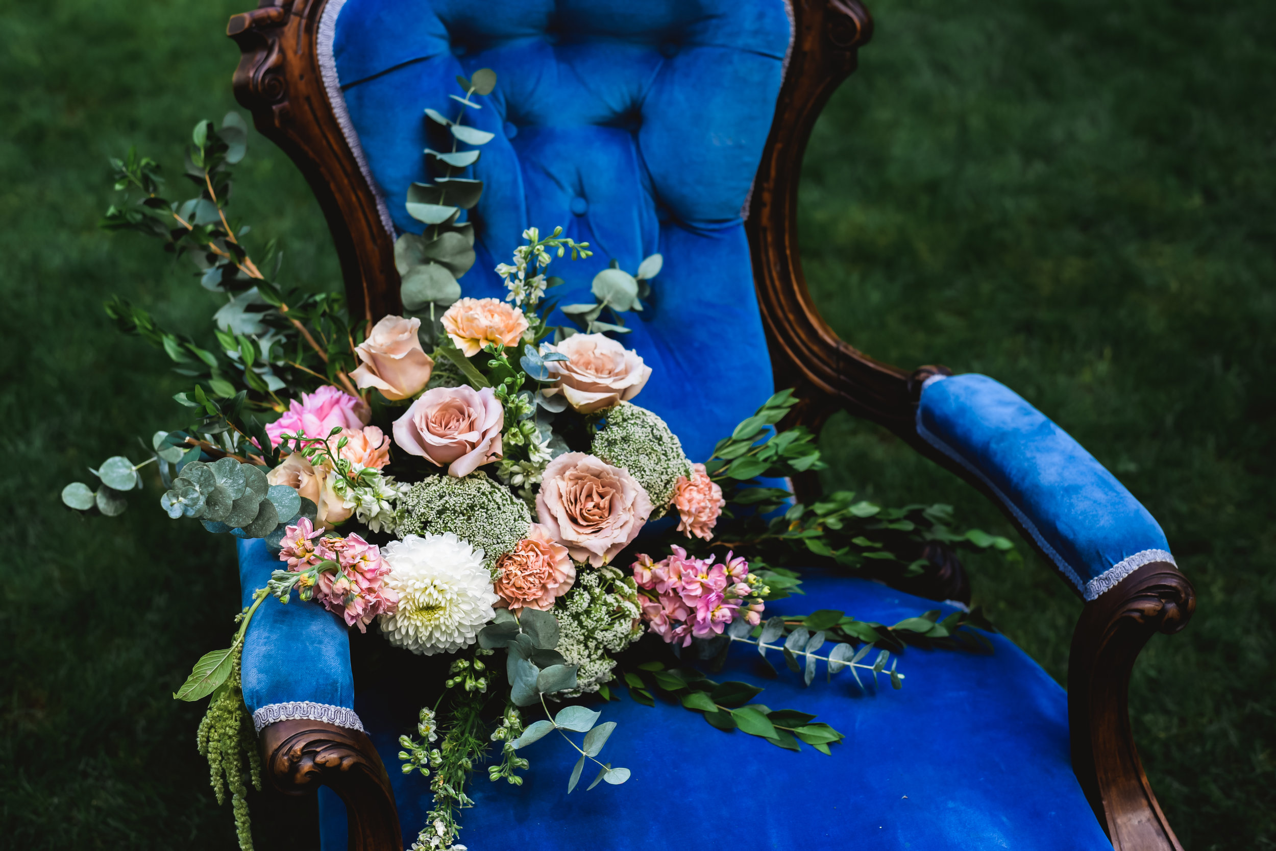 Blue chair with bouquet