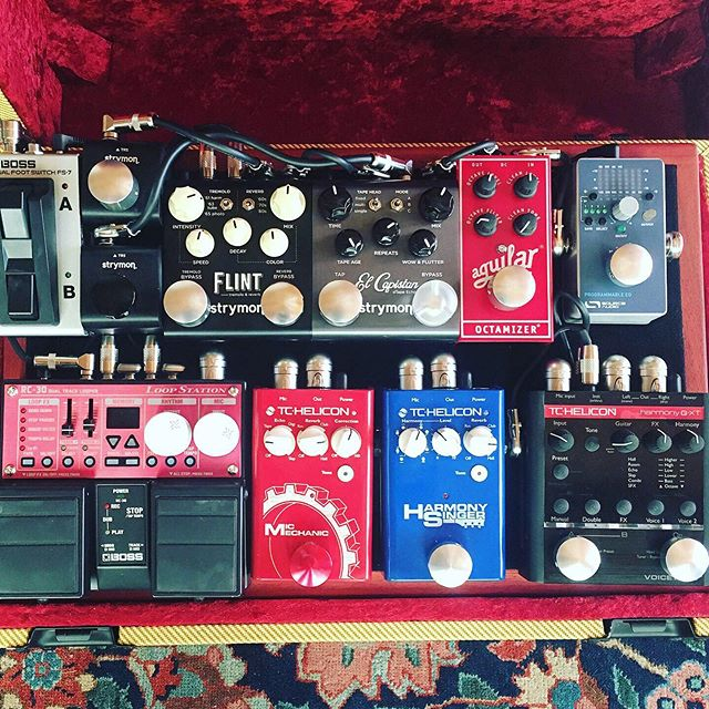 """Another photo of my """"improv live"""" pedal board with two track looper, vocal harmony effects, bass octave pedal, guitar effects and more. This setup enables me to create lush textures and studio post production effects in real time. Shout out to WestCoast Pedal board for the awesome wiring job and custom wood board!"""