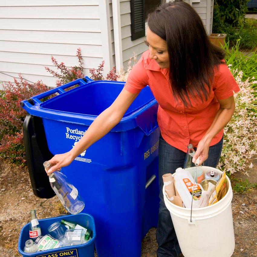 woman_sort_recycle_glass_bin.jpg