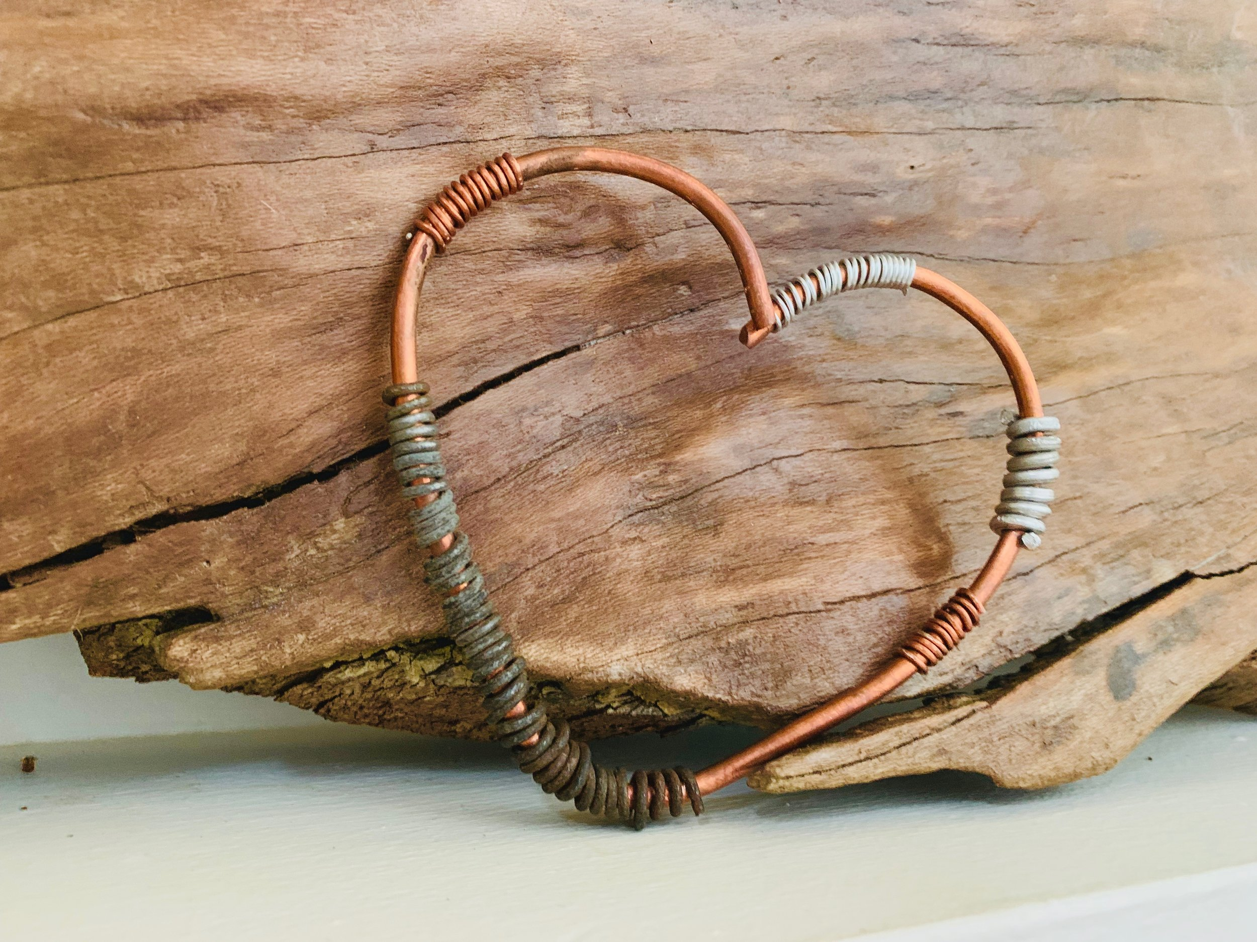 Handmade copper steampunk style heart. Each 5 inch heart is handmade by August, our heart artisan, with care and love. A simple and stylish way to 'give someone your heart', this reminder will affirm that you care and love someone each time they see it. The heart itself is made from 100% copper and accented with aluminum, steel, copper and other assorted wires.