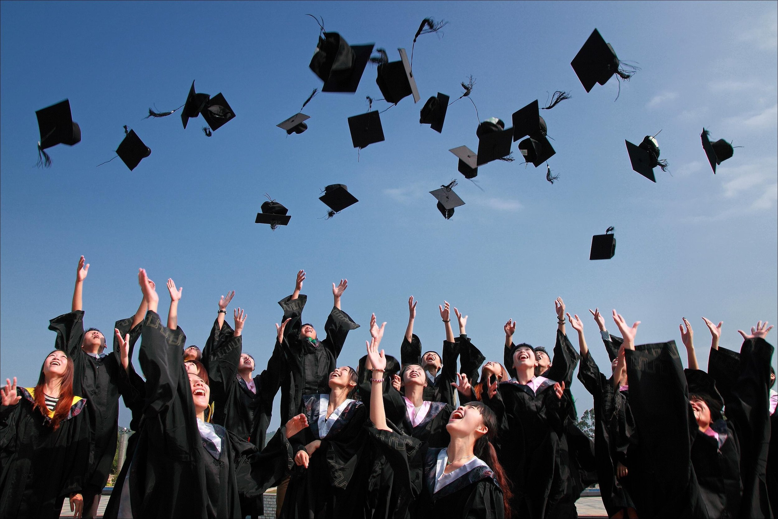 Newly Graduated People Wearing Black Academy Gowns Throwing Hats Up in the Air via Pixbay