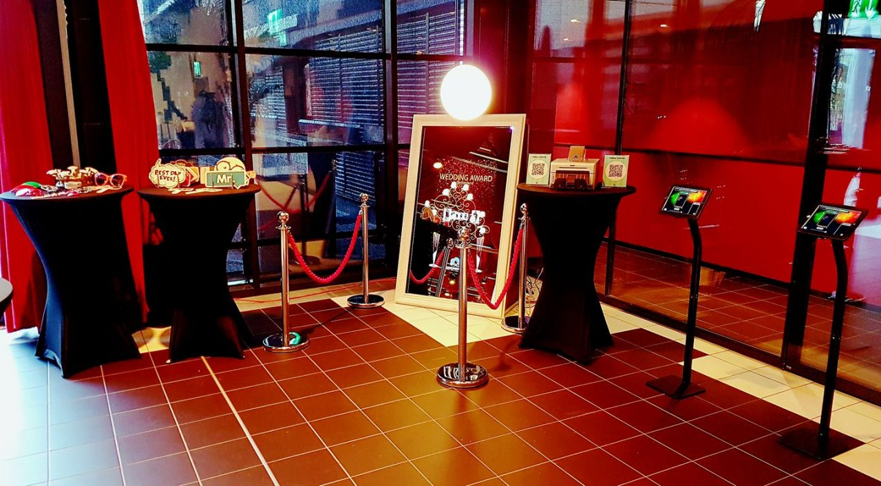 """The Mirror Booth - Imagine your guests will walk up to the full length mirror and colorful animations and voice prompts will invite them to engage in a magical, interactive """"selfie"""" experience resulting in a personalized photo keepsake of your weddings or special event!"""