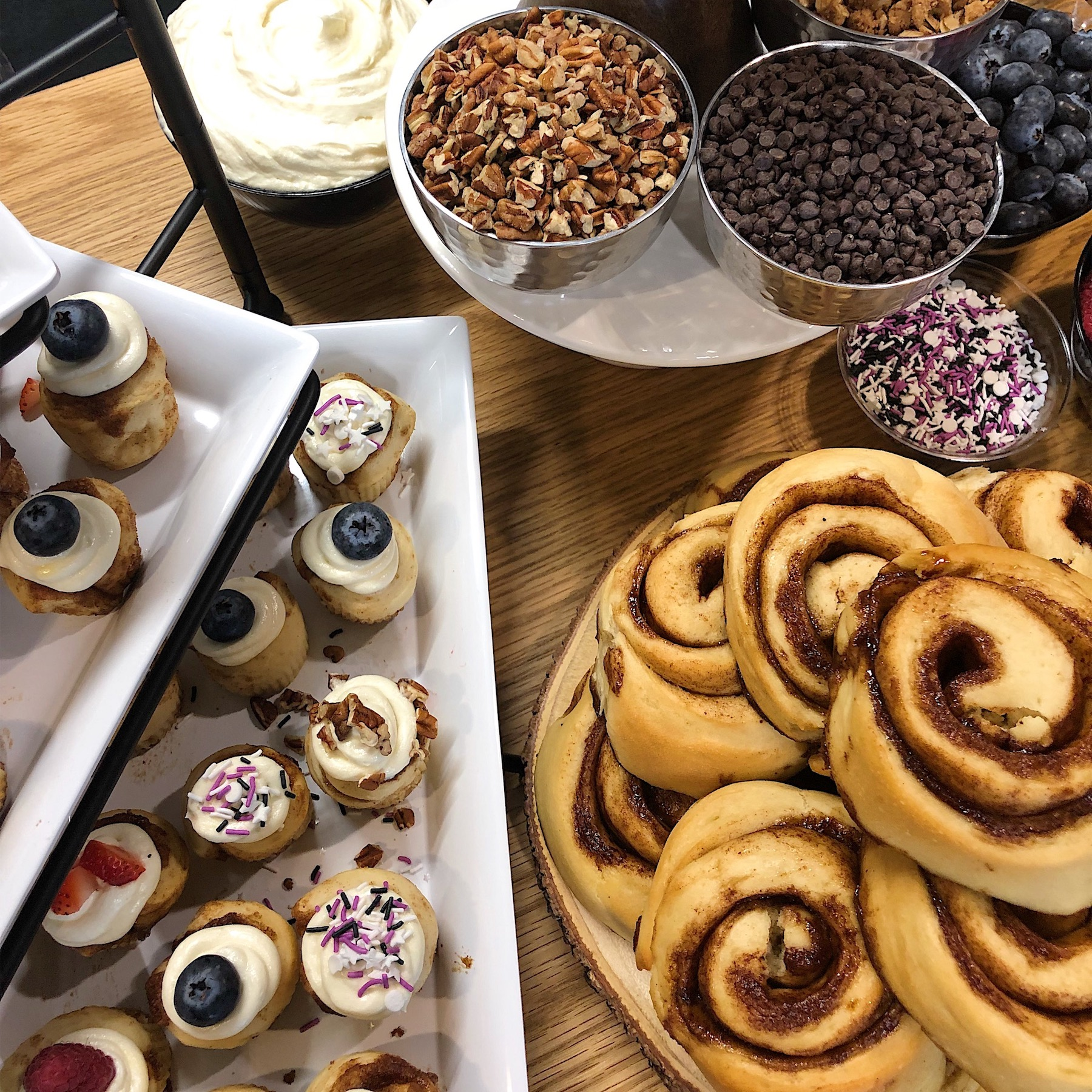 DIY CINNAMON ROLL BAR - Mix and match toppings to create your own Cinnaholic experience.