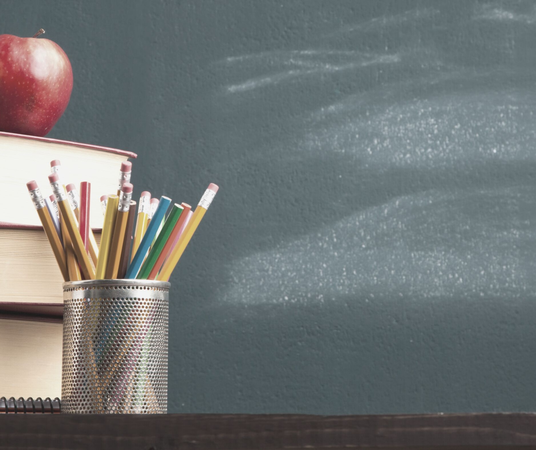 Image of chalkboard books and pencil holder with Apple