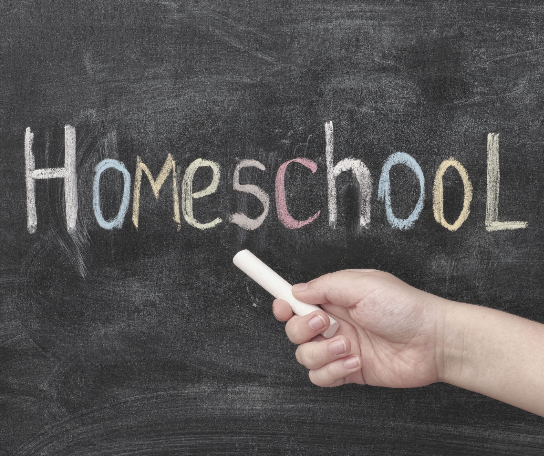 """Image of chalkboard with hand writing with chalk """"HomeSchool"""""""
