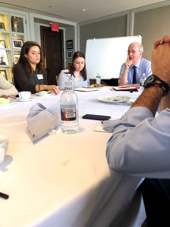 CAP Fellows Gina Vitale and Sarah Nordberg listen to Presenter  and Professor John Kingsdale during the View from the Top portion of the Module on June 26 2019