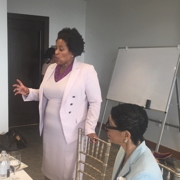 NAACP President and Attorney Tanisha Sullivan speaks to the Fellows about the importance of identifying and collaborating with Stakeholders at the UMass club on July 17.