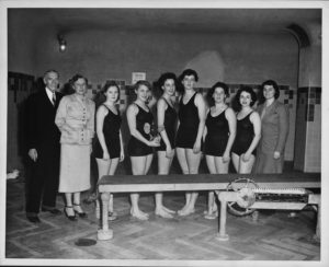 Ester Foley, NYU Head Coach, and her female swim team in the 1950s. You still couldn't swim during your 'special time of the month', but women like Ester helped turn the tide in establishing true competitive female teams.