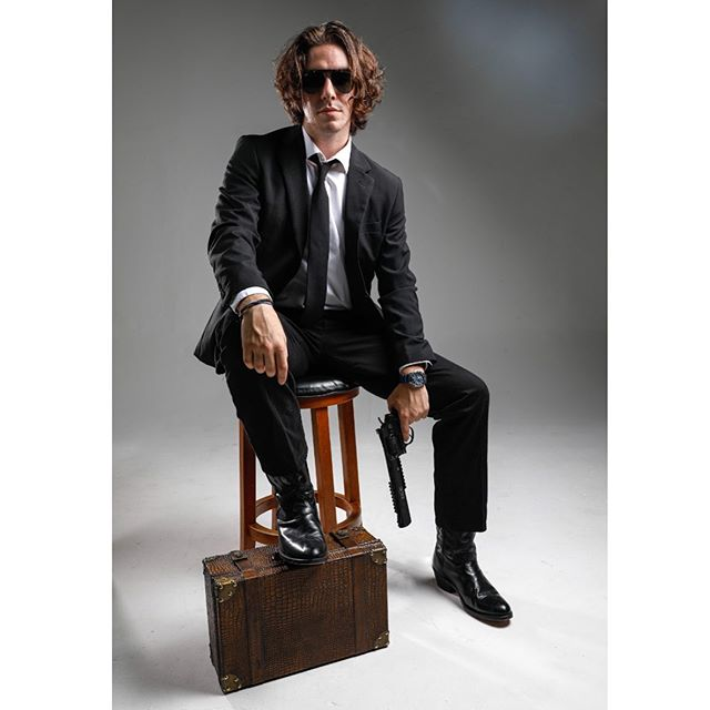Business  #suit #portrait #photo #photography #cannon #camera #lens #nikon #headshot #suit #gun #briefcase #studio #palacemedia #symbolic #model #fashion #shades #corporate