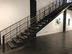 "The stairway at ReCreative gallery where the ""black box"" installation will go…"