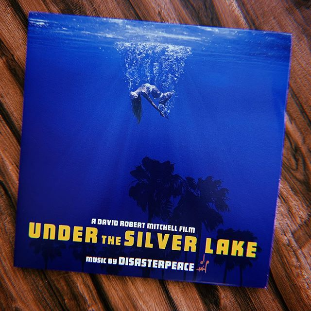 """This mornings soundtrack is the unbelievable score by the fantastic @dzasterpeace from the film """"Under the Silver Lake."""" Signed by the man himself! ⠀⠀⠀ ⠀ The fine folks at @officialmilanrecords did an outstanding job on the artwork/ layout. Gorgeous all around! ⠀⠀⠀ ⠀ Not only is this score amazing, but this film is quite literally my favorite film of 2019. If you've not seen it, but you like heady movies with killer music, get on it ASAP! ⠀⠀⠀ ⠀ #vinyl #vinylcollector #vinylcollective #instavinyl #vinyl #records #vinyljunkies #vinylingclub #music #nowplaying #nowspinning # love #instagood #instamusic #photooftheday #hailsatan #me  #listeningparty #LP #sharingneedleswithfriends #snwfvinylclub #underthesilverlake #disasterpeace"""