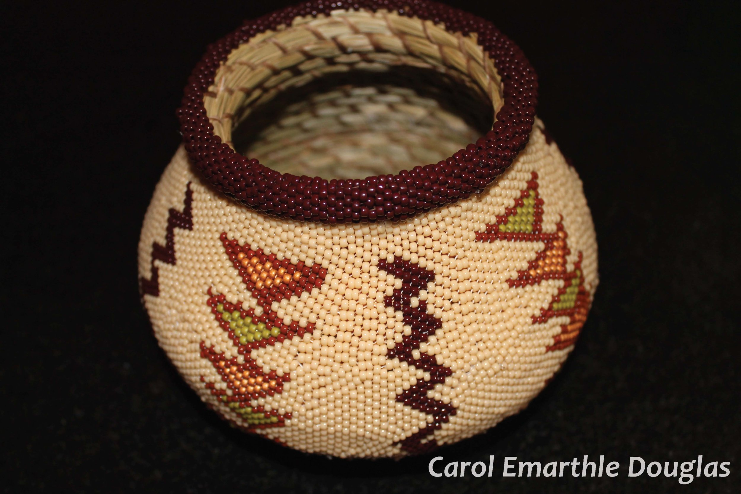 Beyond Coiled Baskets… - Beads may adorn her work as baskets, or her miniatures are made as wearable art.