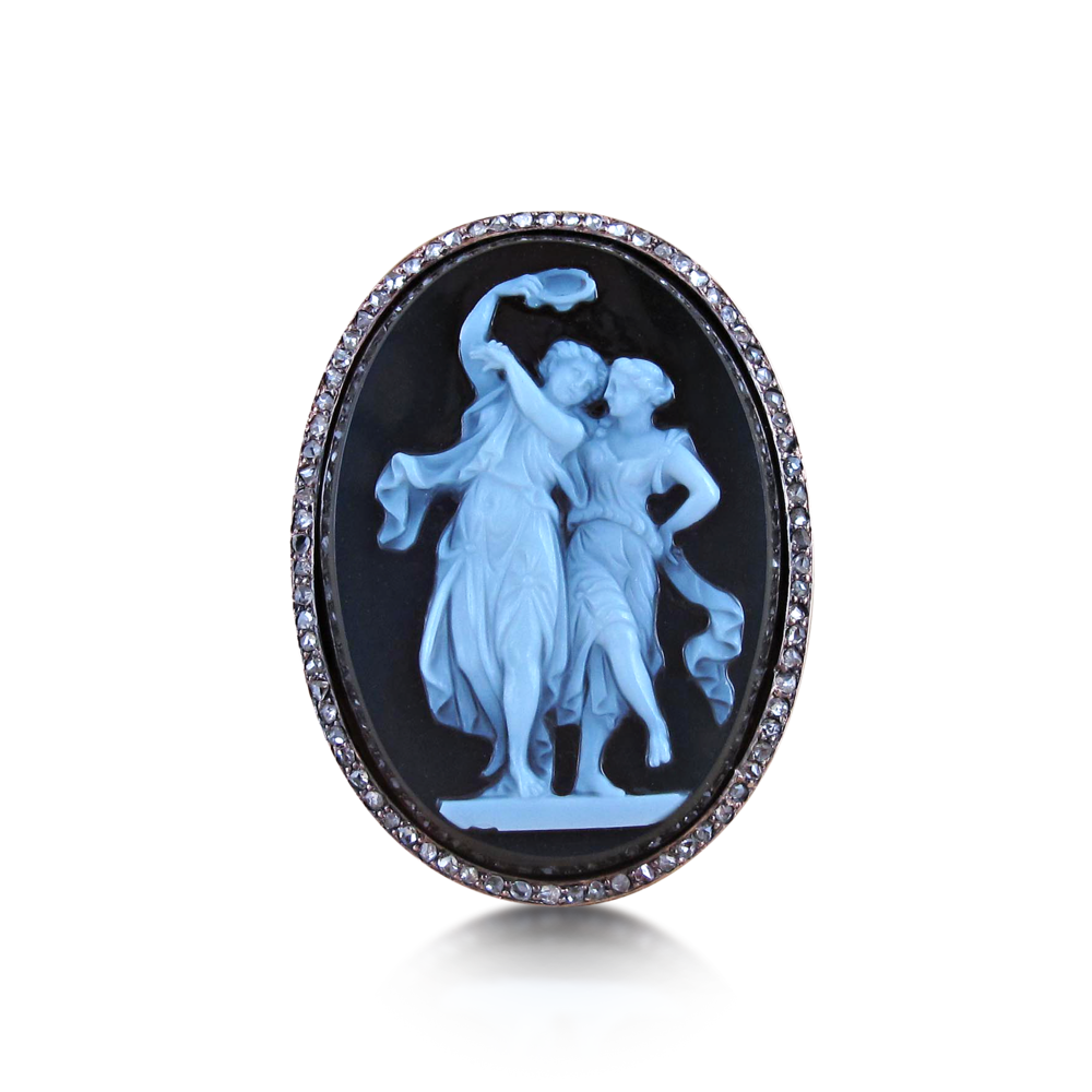 For the eternal romantic, present her with an antique cameo and diamond ring. This agate sardonyx cameo depicts two dancing women, one holding a tambourine to the rose-cut diamond surround. Mounted in 18k pink gold, circa 1880.