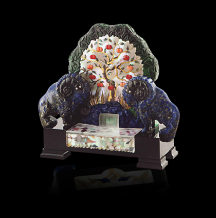 """The """"Tree of Knowledge of Good and Evil"""". A Unique Art Deco Clock, inspired by the biblical account of The Garden of Eden, includes two lapis lazuli rams, a rock crystal river, and mother of pearl inlaid with creatures. Displayed at the 1939 World Fair and offered as Lot 229 for sale at Sotheby's in a New York sale, titled """"Magnificent Jewels"""" in April 2002. It is now in the permanent Black, Starr & Frost museum collection. By Black, Starr & Frost."""