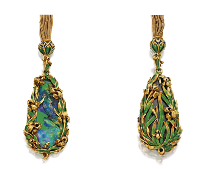 A Gold, Opal and Enamel Sautoir. The drop-shaped black opal measuring approximately 16.0 by 5.1 mm, within a frame of gold irises accented by green enamel, extending to an openwork design of irises on the reverse, suspended from a multi-strand gold foxtail-link chain with a pendant element, slide bead and clasp decorated with blue and green enamel, signed M&Co., circa 1900.