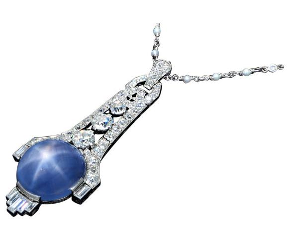 An Art Deco Platinum Blue Star Sapphire Diamond Pendant, by J.E. Caldwell.