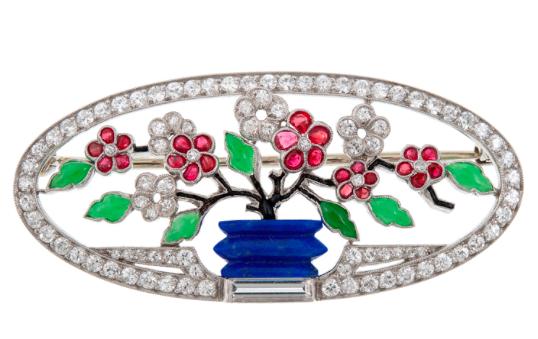 An Art Deco Diamond, Ruby, Carved Jade and Lapis Lazuli Brooch, circa 1925.