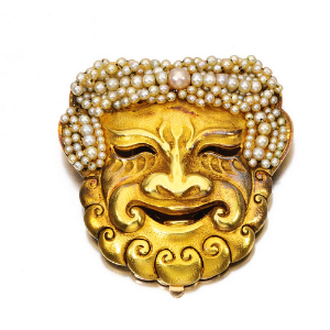 Rene Boivin Theatrical Mask Brooch, by Rene Boivin circa 1910.