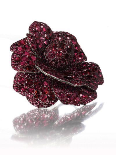A Ruby Camellia brooch by JAR, Lily Safra Collection.