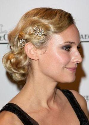 Diane Kruger wearing dress clips in hair.