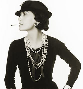 Coco Chanel was one of the first women to wear trousers, cut her hair, reject the corset and to wear rope of pearls with casual-wear.