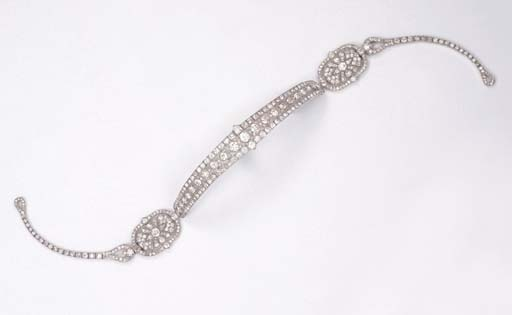 Photo from www.christies.com   A Fine Art Deco Metamorphic Diamond Bandeau, by Cartier The central headband of a graduated old-cut diamond shaped-collet line within diamond borders, two oval side panels of foliate design to the diamond line sides, the central part forming a brooch/bracelet, also forming a choker necklace with the diamond line sides, the side panels forming a pendant necklace, one oval panel forming a brooch, circa 1925, with French assay marks for platinum, in original pink leather fitted case (damaged), with all fittings, adaption tool and contemporary drawing (damaged) of bandeau One oval panel signed Cartier, Paris, London, New York (5)