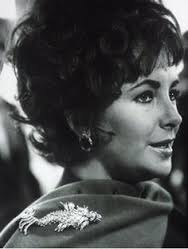 Elizabeth Taylor wearing The Night of the Iguana dolphin brooch.