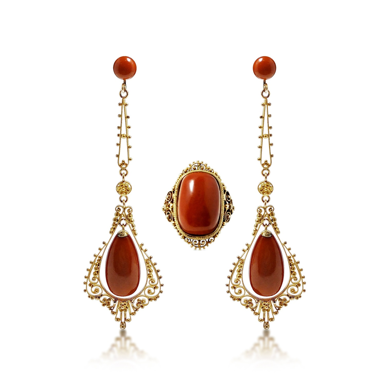 A Set of Yellow Gold and Coral Ear Pendants with Matching Ring   The vibrant hue of gorgeous red coral takes centrestage in this set, which features a pair of dangling earrings with round bead and drop-shaped coral, and a ring with a cushion-cut coral. Accentuating the gems is masterful gold beading and rope work. The ear pendants measure approximately 7.1 cm long, while the ring is sized 5.5.
