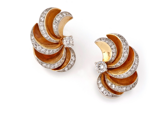 A Pair of Yellow Gold and Diamond Swirl Earrings, By René Boivin, Circa 1937   Flaunting old European and round-cut diamonds mounted on yellow gold, the earrings are designed in a swirl design very popular in the '50s and '60s. They also come with French hallmarks and an authenticity certificate from jewellery historian-expert Madame Françoise Cailles. They measure approximately 1.2cm by 2.5cm.