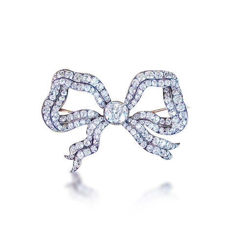 An antique bow brooch set with Old Mine Cut diamonds, circa 1890, previously sold at Revival Jewels