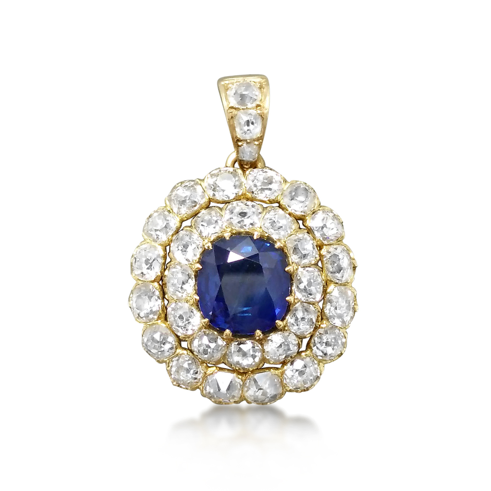 An antique pendant set with a blue sapphire surrounded by Old Mine Cut diamonds, previously sold at Revival Jewels
