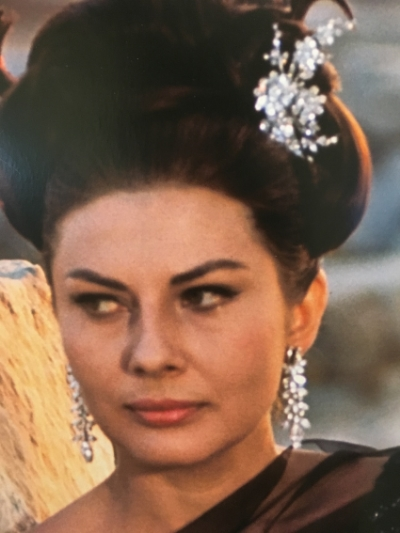 Princess Soraya of Iran, on the set of the film I Tre Volti in 1964, also wearing a Bulgari tremblant brooch in her hair.