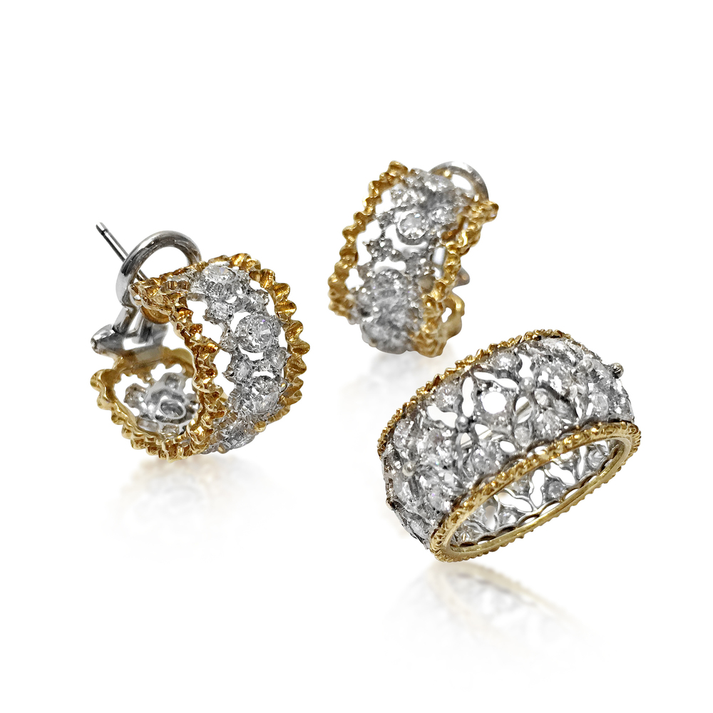 Now available at Revival Jewels: a set of 18k gold and diamond ring and earrings. Of openwork and lacey-edge design, the ring is set with 36 circular-cut diamonds, and the half-hoop earrings set with 32 circular-cut diamonds each, mounted in 18K white and yellow gold, ring size is 4 1/8, while the earrings measure 1.5cm in length. Signed Buccellati, Italy. Total diamond weight approx. 1.0-2.0 carats.