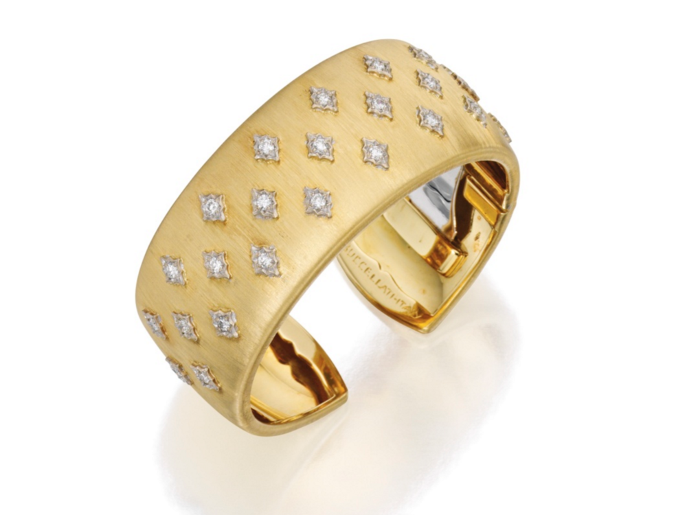 Sold at a Sotheby's New York auction in 2015 for USD47,500, higher than its estimate of USD20,000-30,000, was this diamond and gold cuff bangle signed M. Buccellati. It is decorated with navette-shaped motifs set with round diamonds weighing approximately 1.25 carats.