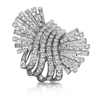 Revival Jewels' Style Suggestion: A diamond double-clip brooch by John Rubel, circa 1945, which can be worn separately as scatter brooches or together as a single item.    Click here    for details.