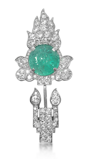 Revival Jewels' Style Suggestion:    An Art Deco diamond and emerald jabot brooch by Cartier, circa 1920.    Elegant and tasteful.