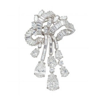 Revival Jewels' Style Suggestion: A diamond brooch by Boucheron, which features an articulated cascade of diamonds that will immediately draw attention to a low-back silhouette.    Click here    for details.