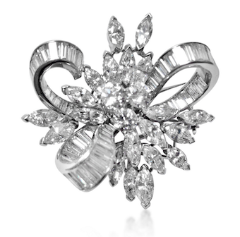 Revival Jewels' Style Suggestion: A platinum and diamond brooch by Van Cleef & Arpels, circa 1950, which matches any colour, classic outfit, pearl sautoir or diamond necklace.    Click here    for details.