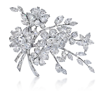 Revival Jewels' Style Suggestion: A diamond and white gold tremblant brooch by Bulgari, circa 1950s, which will be as stunning on a chignon as it is on a dress.    Click here    for details.