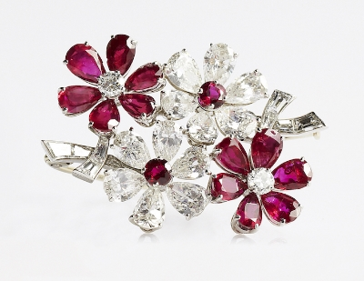 Revival Jewels' Style Suggestion: A ruby and diamond floral brooch by Van Cleef & Arpels, circa late 1950s, whose glamour, colour and sparkle will make it a worthy talking point.    Click here   for details.
