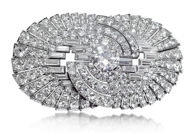 Revival Jewels' Style Suggestion: A diamond and platinum brooch of French origin, whose neat, geometric double-circular motif will make an excellent adornment for many styles of hats and outfits.    Click here    for details.