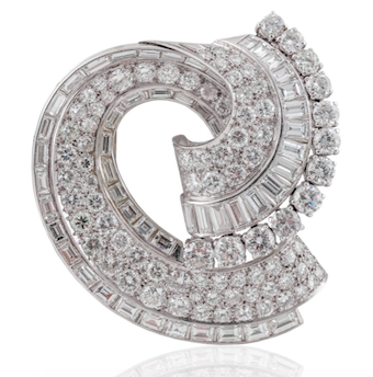 Revival Jewels' Style Suggestion: A diamond clip brooch, circa 1950s, whose simple swirl design and proportions afford it great versatility for different types of attire, winter wear or not.    Click here    for details.