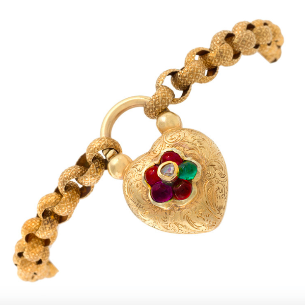 "An antique 15k gold bracelet with gold heart locket spelling out ""Regard"", available at Revival Jewels."