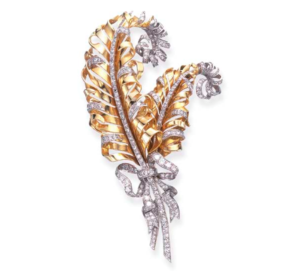 A Retro Diamond and Gold Feather Brooch, by Fulco Di Verdura for Paul Flato.   Designed as twin sculpted gold plumes, enhanced by single-cut diamond trim, tied with an old European and single-cut diamond ribbon, mounted in platinum and gold, circa 1935.  One of the pieces offered in the Doris Duke Collection of Important Jewellery at Christie's, 2nd June 2004 for an estimate of $8000 - $10000. Price realised $23,900.