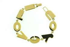 """""""Say-it-in-jewels"""" was an immensely successful line of jewellery that could be personalised with messages and monograms.  A Gold 'I Love You' Bracelet, by Paul Flato, circa 1940"""