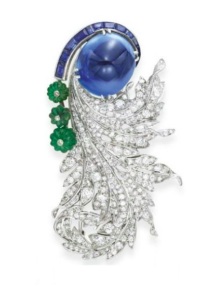 A Sugarloaf Cabochon Sapphire, Carved Emerald and Diamond Brooch, by Paul Flato, circa 1937